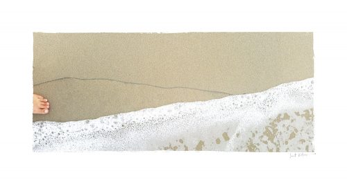 A wide photo of a line on the beach with water coming in